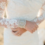 Lace Long Sleeve Wedding Dress with a Jeweled Cuff Bracelet | Samantha Kirk Photography | Red Velvet - Luxe Winter Styling in Leather and Lace