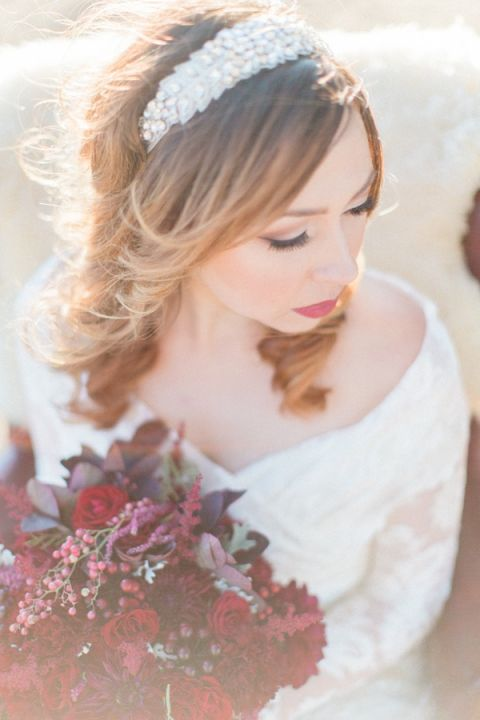 Dramatic Red and White Winter Bride with a Jeweled Headpiece