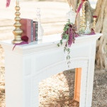 Vintage Mantelpiece for an Elegant Winter Wedding Ceremony Altar | Samantha Kirk Photography | Red Velvet - Luxe Winter Styling in Leather and Lace