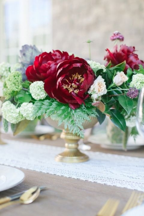 Ivory burgundy and gold wedding styling at castle cliff