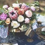 Protea and Rose Centerpiece with Gold and Teal Decor | Cassandra Farley Photography | Winter Woodlands Wedding with Rich Bohemian Details and Luxe Jewel Tones
