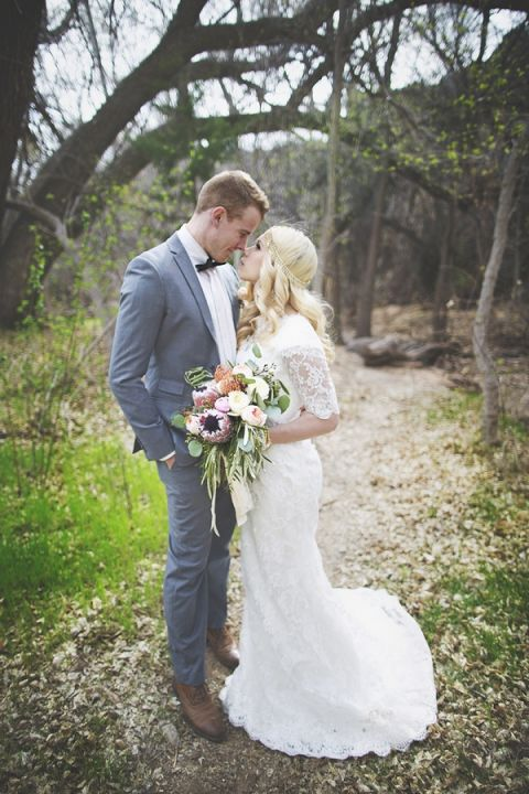 Boho Lace Wedding Dress with a Protea Bouquet | Cassandra Farley Photography | Winter Woodlands Wedding with Rich Bohemian Details and Luxe Jewel Tones