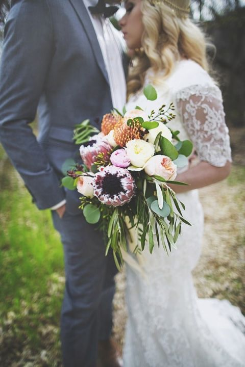 Bouquet with Pincushion and King Protea Blooms | Cassandra Farley Photography | Winter Woodlands Wedding with Rich Bohemian Details and Luxe Jewel Tones