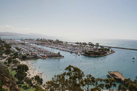 Gorgeous View of Laguna Beach Harbor | Vitaly M Photography | Black Tie Coastal Wedding with Classic Beach Details