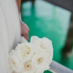 Classic White Garden Rose Bouquet | Vitaly M Photography | Black Tie Coastal Wedding with Classic Beach Details