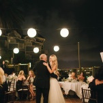 Hanging Lanterns over a Seaside Terrace Wedding Reception | Vitaly M Photography | Black Tie Coastal Wedding with Classic Beach Details