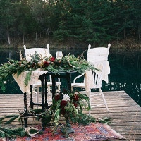 Lakeside Sweetheart Table with Rich Botanical Details | Nicole Colwell Photography | https://heyweddinglady.com/festive-styled-wedding-in-the-winter-woods-with-a-corgi-in-a-holiday-sweater/