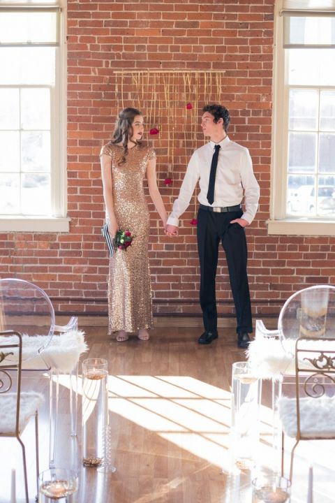Modern Glam Wedding Ceremony with Exposed Brick Walls and a Gold Ribbon Backdrop | Kim Lyn Photography | Sequins and Stripes for an Industrial Glam Loft Wedding