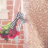 Red Rose Bouquet with a Black and White Striped Ribbon | Kim Lyn Photography | Sequins and Stripes for an Industrial Glam Loft Wedding