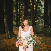 Romantic Woodland Bride with a Side Braided Updo and Ombre Bouquet | Danaea Li Photography and A Day to Remember Events | Romantic Vintage Botanical Wedding Shoot at a Rustic Winery
