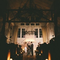 Candlelight Wedding Ceremony in front of the Fireplace   onelove photography   Classic Winter Elegance for a Rustic Vintage Barn Wedding