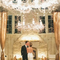 Stunning Wedding Lighting in an Elegant Barn | onelove photography | Classic Winter Elegance for a Rustic Vintage Barn Wedding