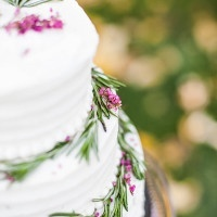 Simple Buttercream Wedding Cake with a Floral Garland | Samantha McFarlen Photography | Late Winter Sun - Sparkling Silver and Berry Wedding Shoot