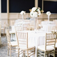 White and Gold Wedding Reception with Magnolia Leaf Centerpieces | Marissa Lambert Photography | White Peonies and Floral Lace for a Classic New Orleans Wedding