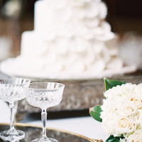 Vintage Crystal Champagne Coupes for the Bride and Groom | Marissa Lambert Photography | White Peonies and Floral Lace for a Classic New Orleans Wedding