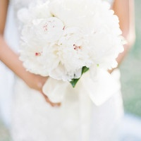 Ribbon Tied Bouquet of White Peonies with Blush Hearts | Marissa Lambert Photography | White Peonies and Floral Lace for a Classic New Orleans Wedding
