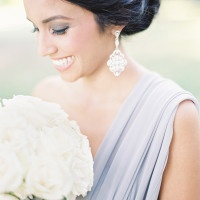 Romantic Gray Bridesmaid Dress with Statement Earrings | Marissa Lambert Photography | White Peonies and Floral Lace for a Classic New Orleans Wedding