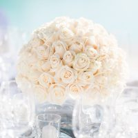 Classic Ivory Rosebud Centerpiece | Brancoprata | Stylish White and Silver Destination Wedding in Portugal
