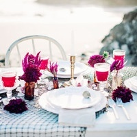 Pops of Amber Glass and Bright Berry Flowers on a White Wedding Table | Grace Aston Photography | Swept Away - Mermaid Inspired Wedding on the Coast