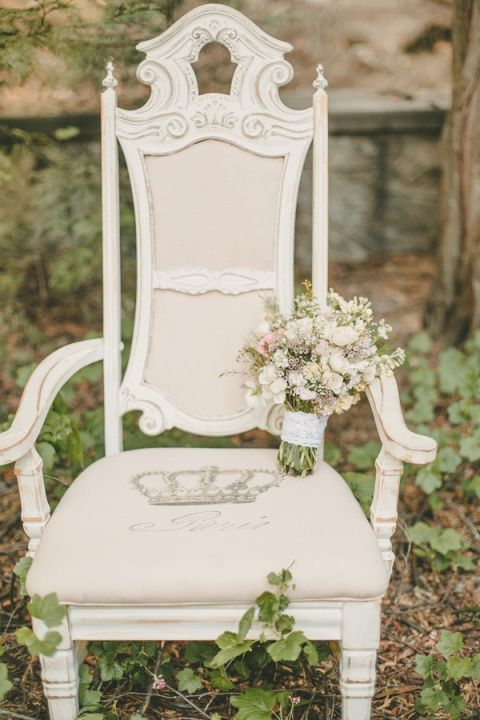 Vintage Shabby Chic Chair with a Pastel Wildflower Bouquet