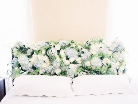 A Blooming Headboard of Spring Flowers | Orange Photographie and Beargrass Gardens | Blissful Bridal Shoot - Getting Ready for the Wedding Day - http://heyweddinglady.com/blissful-bridal-shoot-getting-ready-for-the-wedding-day/