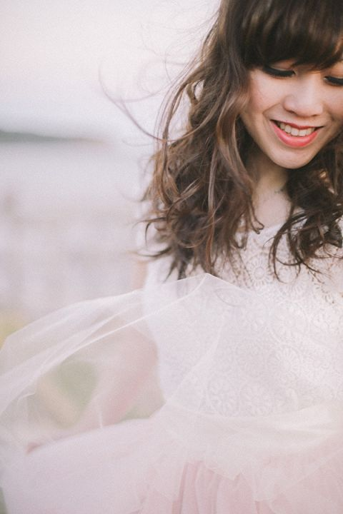 Gorgeous Windswept Bridal Portraits | Jenny Sun Photography | A Romantic Seaside Engagement by Candlelight