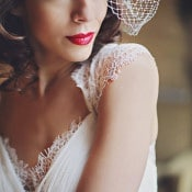 A Birdcage Veil and Bold Red Lips | Olga Thomas Photography | Retro Pastel Wedding Shoot with French Country Style