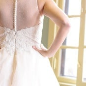 Sheer Wedding Dress Back with Pearl Buttons | Mathew Irving Photography | A Stylish Early Autumn Wedding in the Mountains for an Outdoor Loving Couple