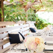 Guest Tables Set Under a Vine Hung Arbor | Royce Sihlis Photography and Created Lovely Events | Sparkling Blush and Champagne Wedding in an Apple Orchard