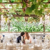 Stunning Arbor Wedding Portraits with Crystal Chandeliers | Royce Sihlis Photography and Created Lovely Events | Sparkling Blush and Champagne Wedding in an Apple Orchard