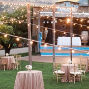 Cocktail Hour with Sequin Linens and Bistro Lighting | Royce Sihlis Photography and Created Lovely Events | Sparkling Blush and Champagne Wedding in an Apple Orchard
