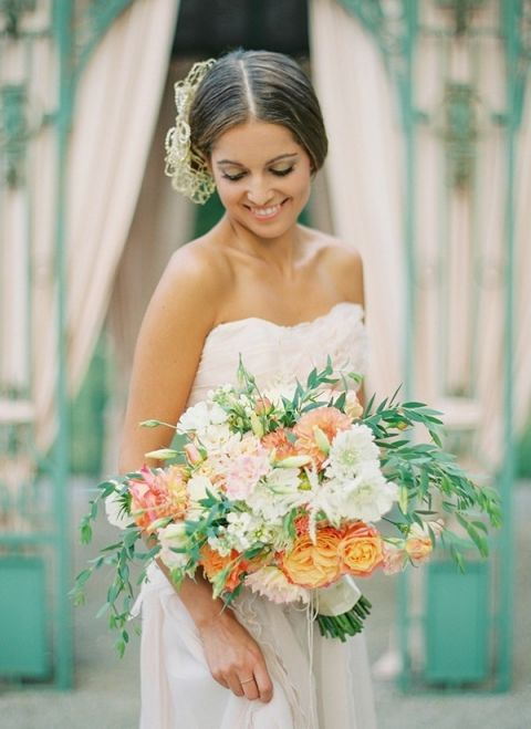 Gorgeous Coral, Peach, and Green Spring Bouquet | Peaches & Mint Photography | A Blooming Spring Wedding full of Lush Flowers in Peach and Fresh Green - https://heyweddinglady.com/blooming-spring-wedding-full-of-lush-flowers/