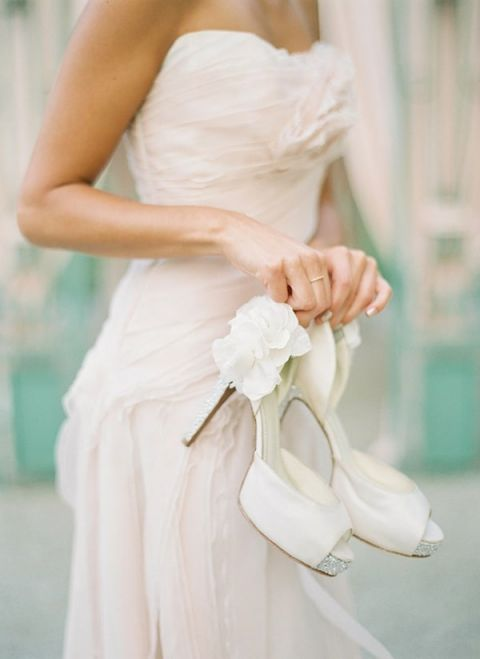 Pale Blush Ruffled Wedding Dress with Ivory Heels | Peaches & Mint Photography | A Blooming Spring Wedding full of Lush Flowers in Peach and Fresh Green - https://heyweddinglady.com/blooming-spring-wedding-full-of-lush-flowers/