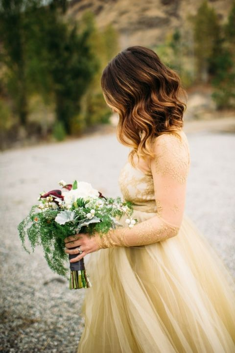 Gorgeous Gold Lace Wedding Dress and Wild Winter Bouquet | Tonie Christine Photography | Starting a New Adventure with A Surprise Vow Renewal - https://heyweddinglady.com/starting-a-new-adventure-with-a-surprise-vow-renewal/
