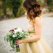 Gorgeous Gold Lace Wedding Dress and Wild Winter Bouquet | Tonie Christine Photography | Starting a New Adventure with A Surprise Vow Renewal - http://heyweddinglady.com/starting-a-new-adventure-with-a-surprise-vow-renewal/