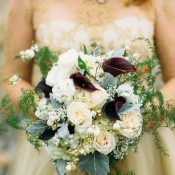 Lush White, Silver, and Burgundy Bouquet | Tonie Christine Photography | Starting a New Adventure with A Surprise Vow Renewal - https://heyweddinglady.com/starting-a-new-adventure-with-a-surprise-vow-renewal/