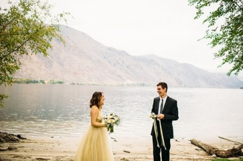 Emotion First Look on the River | Tonie Christine Photography | Starting a New Adventure with A Surprise Vow Renewal - https://heyweddinglady.com/starting-a-new-adventure-with-a-surprise-vow-renewal/