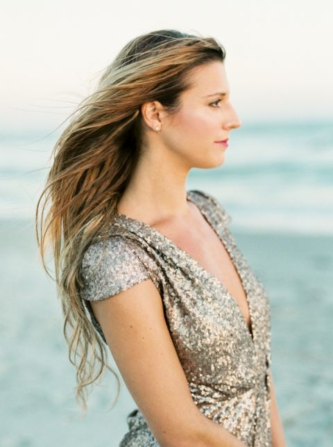 Champagne Sequin Romper and Natural Beachy Hair   JoPhoto   Marsala and Champagne Engagement on the Beach - http://heyweddinglady.com/marsala-and-champagne-engagement-on-the-beach/