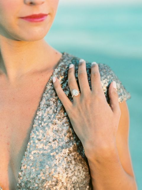 Elegant Oval Engagement Ring and a Champagne Sequin Romper | JoPhoto | Marsala and Champagne Engagement on the Beach - https://heyweddinglady.com/marsala-and-champagne-engagement-on-the-beach/
