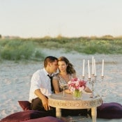 A Romantic Table for Two on the Dunes | JoPhoto | Marsala and Champagne Engagement on the Beach - https://heyweddinglady.com/marsala-and-champagne-engagement-on-the-beach/