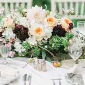 Luminous Peach Flowers with Rich Burgundy Dahlias | Rachel May Photography and Amore Events by Cody | Garnet and Rose Gold - An Enchanted Garden Wedding Editorial - https://heyweddinglady.com/garnet-and-rose-gold-an-enchanted-garden-wedding-editorial/