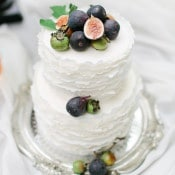 Delicately Ruffled Wedding Cake Topped with Fresh Figs | Rachel May Photography and Amore Events by Cody | Garnet and Rose Gold - An Enchanted Garden Wedding Editorial - https://heyweddinglady.com/garnet-and-rose-gold-an-enchanted-garden-wedding-editorial/