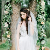 Gorgeous Draped Garland of Flowers and Vines for an Outdoor Ceremony | Rachel May Photography and Amore Events by Cody | Garnet and Rose Gold - An Enchanted Garden Wedding Editorial - http://heyweddinglady.com/garnet-and-rose-gold-an-enchanted-garden-wedding-editorial/