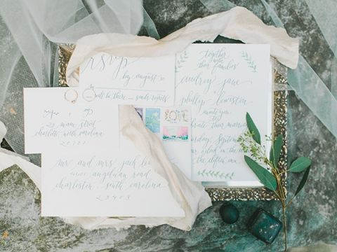 Sweet Botanical Inspired Calligraphy Wedding Invitation | Rachel May Photography and Amore Events by Cody | Garnet and Rose Gold - An Enchanted Garden Wedding Editorial - https://heyweddinglady.com/garnet-and-rose-gold-an-enchanted-garden-wedding-editorial/