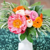 Peony and Ranunculus Centerpiece on Sequin Linens   onelove photography   Bold Colors and Modern Sparkle in Palm Springs for a Glam Desert Wedding