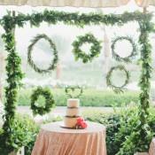 Sequin Wedding Cake Table with a Garland Backdrop | onelove photography | Bold Colors and Modern Sparkle in Palm Springs for a Glam Desert Wedding - http://heyweddinglady.com/bold-colors-and-modern-sparkle-in-palm-springs/