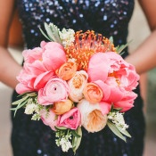 A Coral Peony Bouquet with Navy Sequin Bridesmaid Dress | onelove photography | Bold Colors and Modern Sparkle in Palm Springs for a Glam Desert Wedding