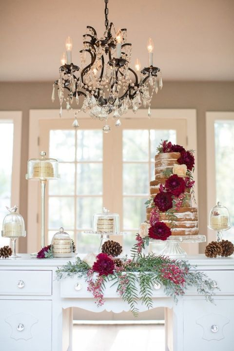 Rustic Fall Wedding Cake Table under a Crystal Chandelier