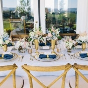 Seersucker Table Linens in Pale Blue and White with Sweet Southern Decor | Lisa Mallory Photography | Preppy Southern Charm Wedding in Blue, Blush, and Gold