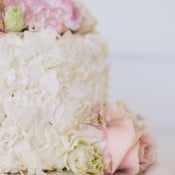 Petite Wedding Cake with Coconut and Blush Flowers | Lisa Mallory Photography | Preppy Southern Charm Wedding in Blue, Blush, and Gold